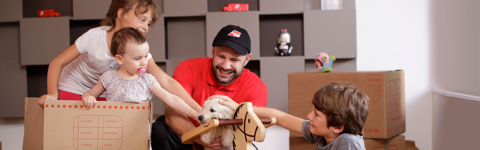 AGS Movers staff member petting dog with kids.