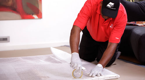 Mover wrapping a painting carefully