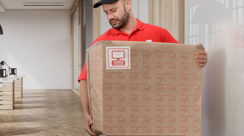 Mover lifting a box in an office